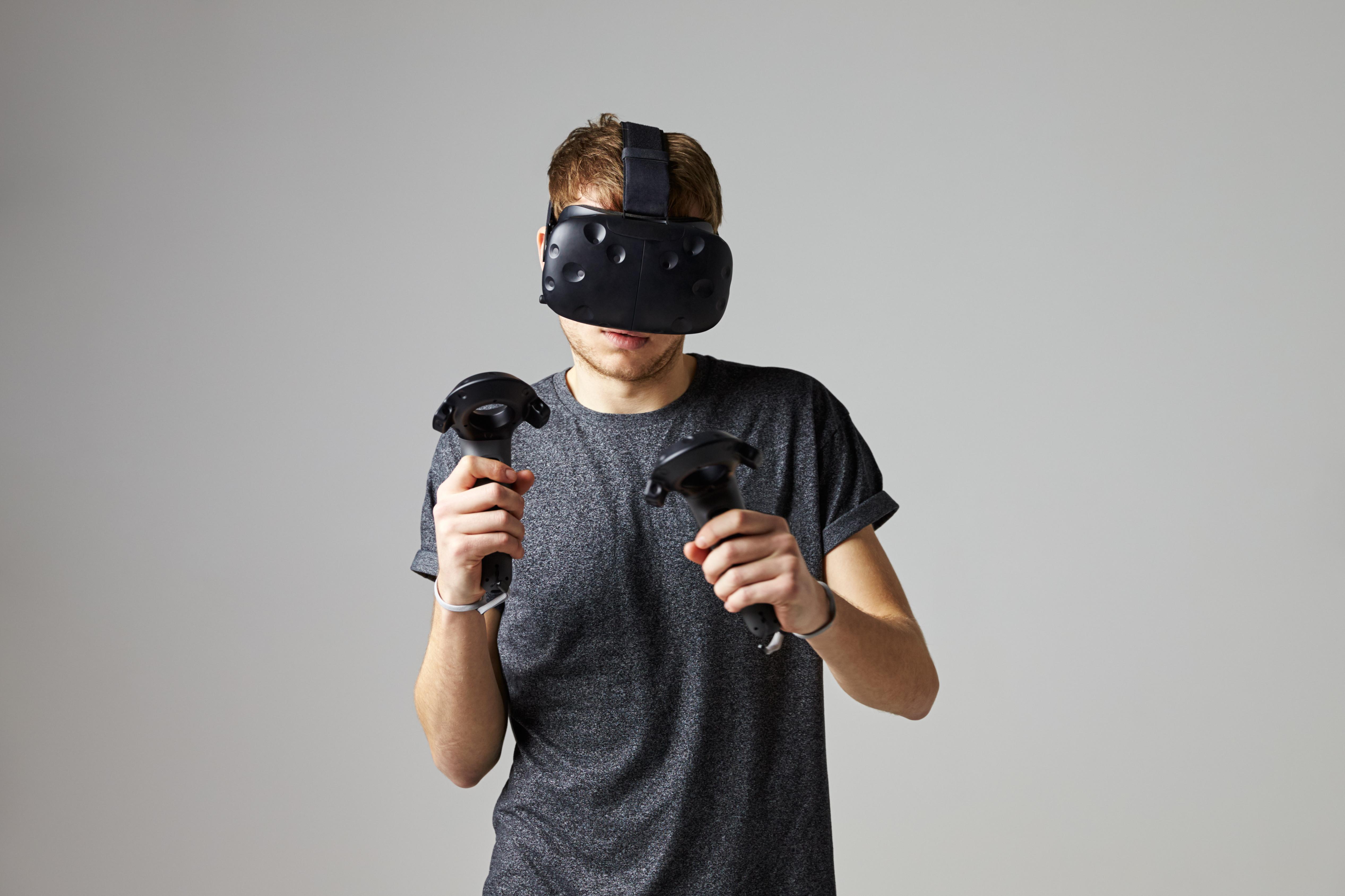 Man In Studio Wearing Virtual Reality Headset Playing Game
